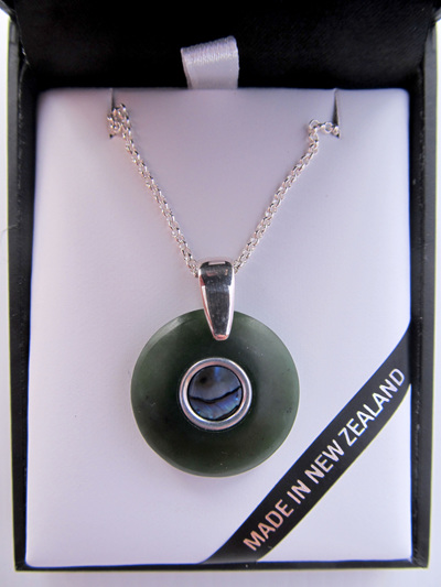 1029 Round doughnut shaped greenstone and silver pendant with Paua inlay
