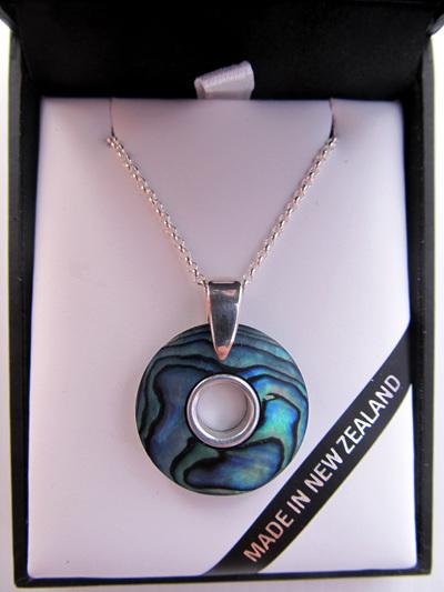 1031 Round Paua doughnut pendant with silver inlay.