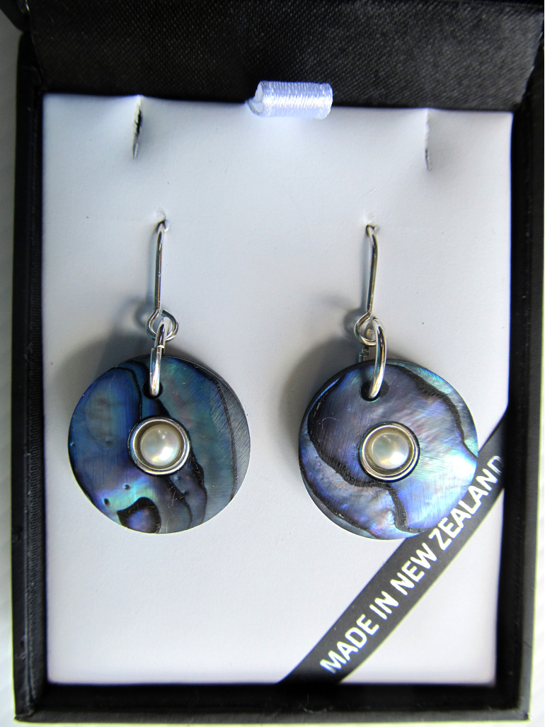 1036 Round douhgnut shaped Paua earrings with silver and pearl centre.