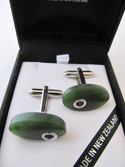 1060 Oval shaped greenstone and silver detail cufflinks.