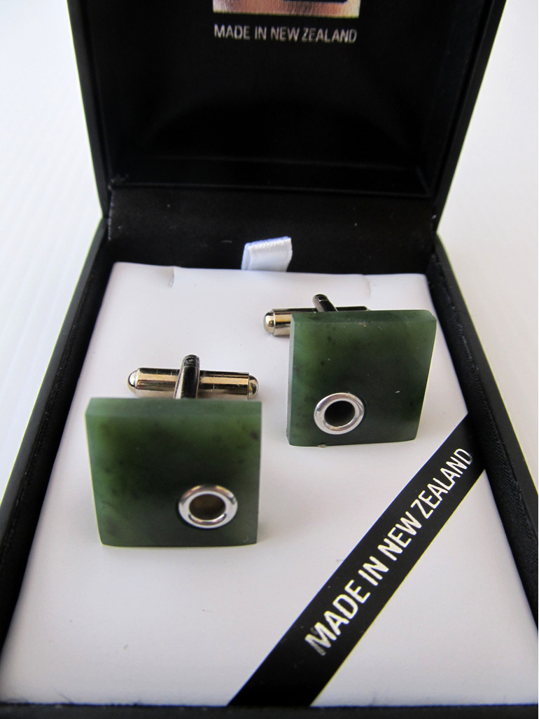 1061 Square shaped greenstone and silver detail cufflinks.