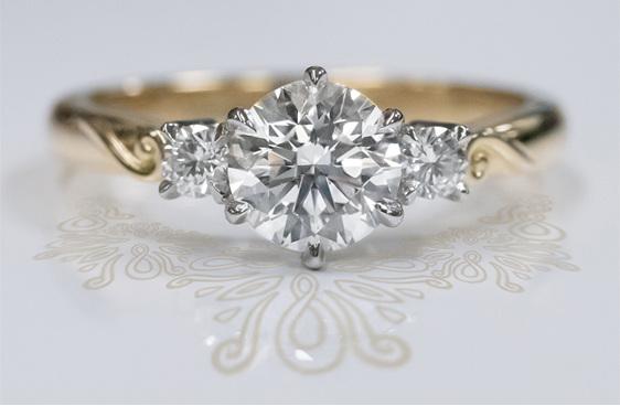 18ct gold platinum diamond three stone engagement ring with koru motif detail