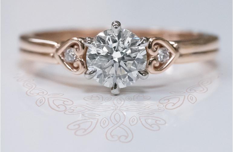 18ct rose gold unique koru heart diamond detail solitaire engagement ring