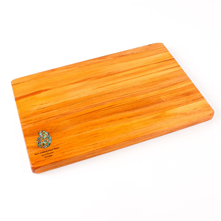 280 x 180 x 14 - rimu cheese board with paua koru