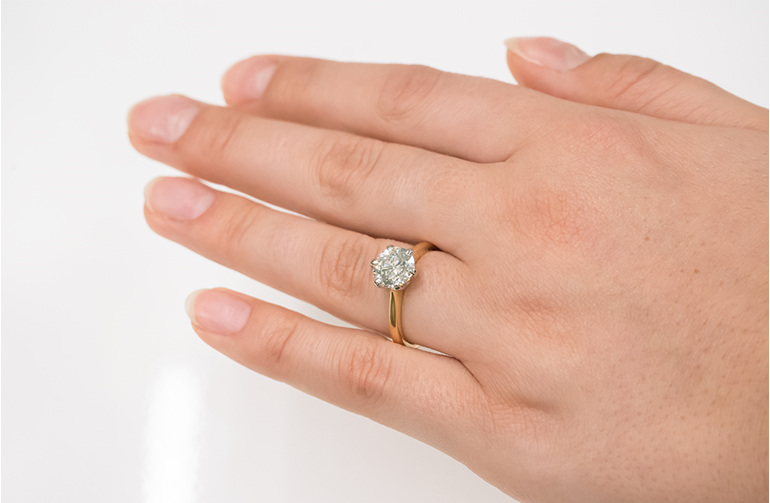 2.012ct brilliant diamond solitaire engagement ring on hand