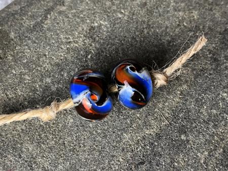 2x Handmade glass beads - cosmic swirl - blue/orange