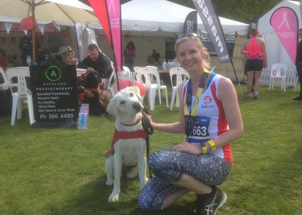 Emma with a Guide Dog at the ASB Auckland Marathon 2016
