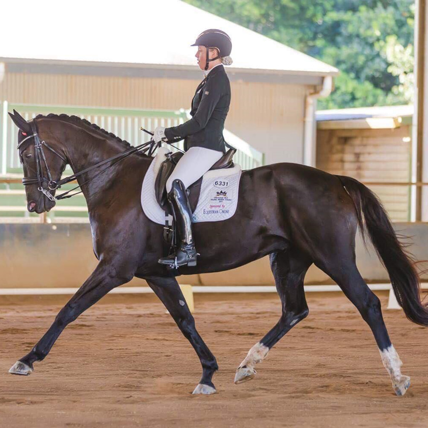 Hope Beerling with Remi Down Under ('Aussie') performing Dressage
