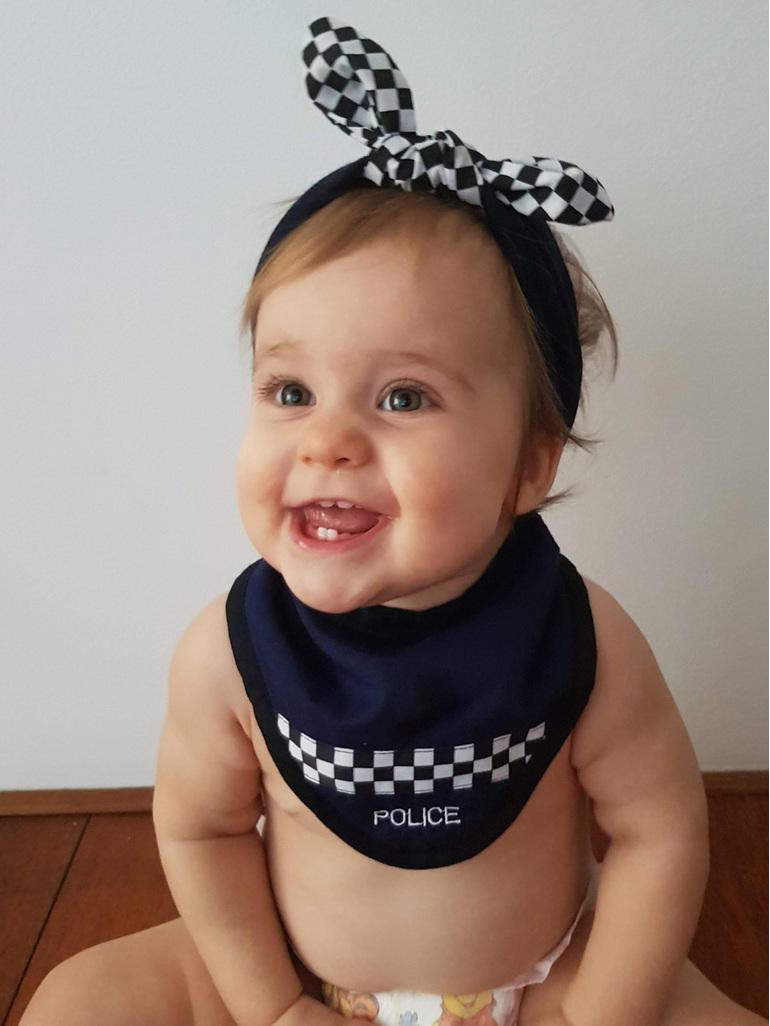 A cute little police dribble bib for baby.