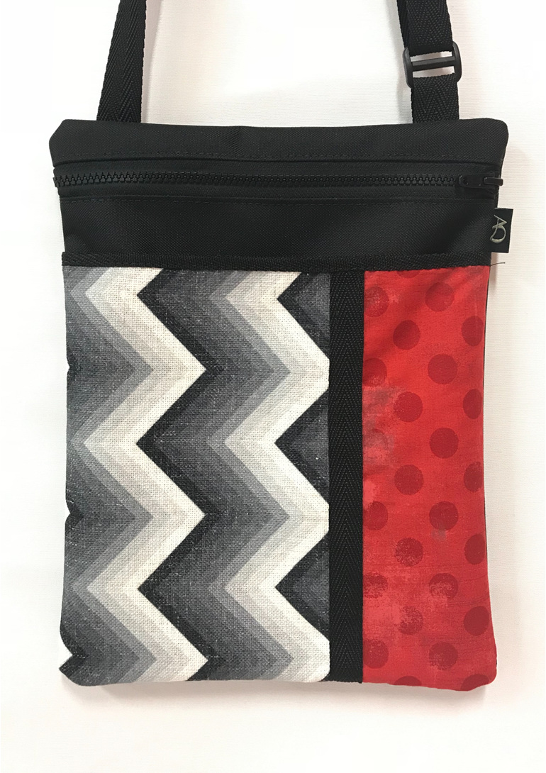A Dory large bag handmade in black, white and red fabric. Designer plus!
