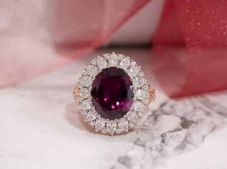 A Garnet Garland - Malaia Garnet and Diamond Ring