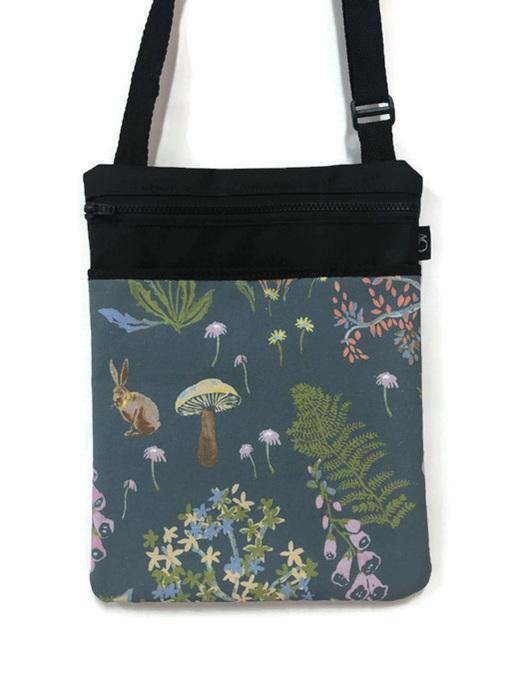 A handbag of blues and greens.  Great over shoulder bag with a slip pocket