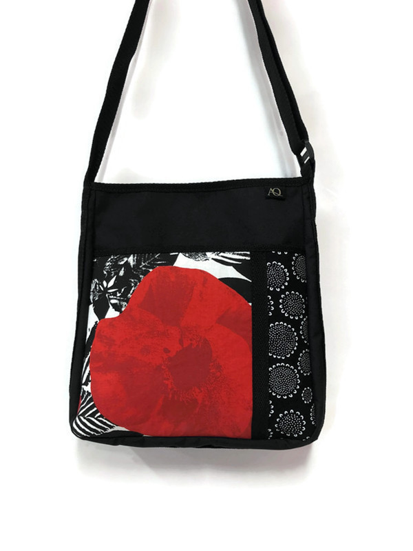 A handbag with red, white and black fabric.