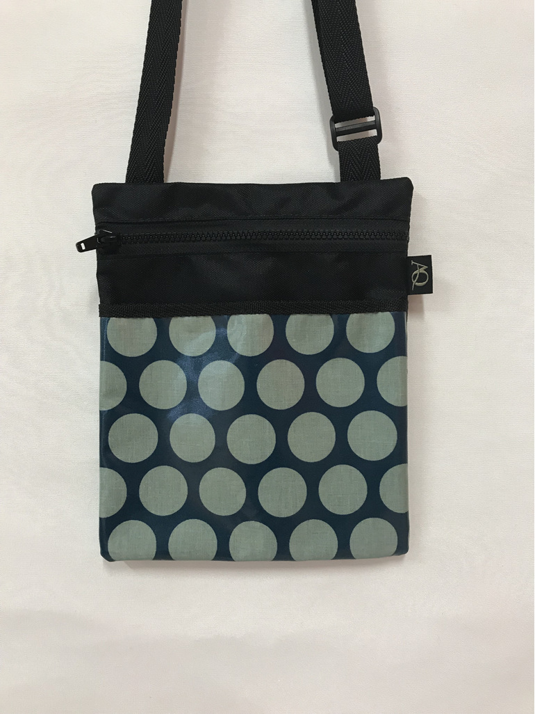 A laminated fabric in teal looks stylish on this handbag.
