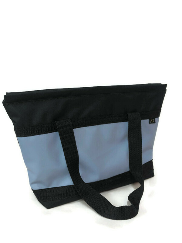 A lilic/blue zippered tote, strong and durable and great for the plane.
