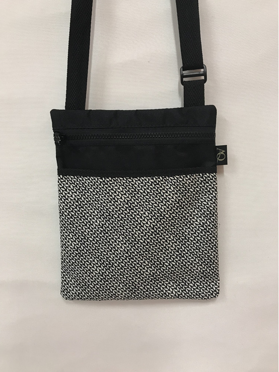 A medium Dory bag with a knitting design in black and white.