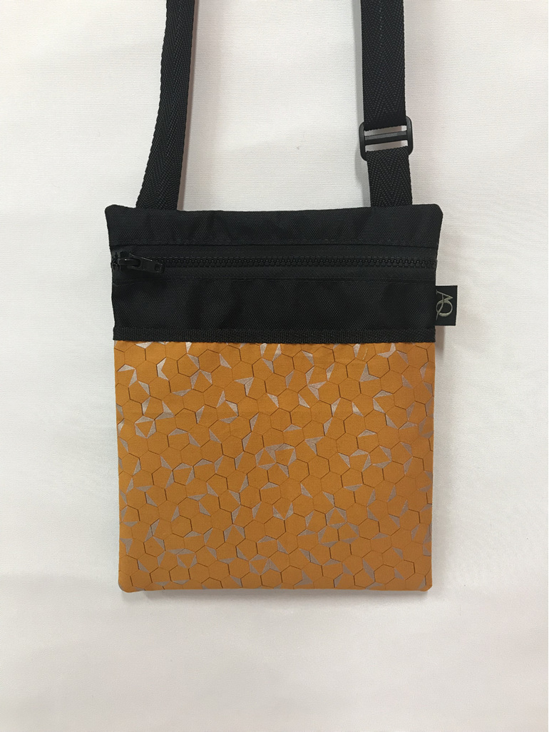 A medium dory handbag in silver & mustard and very stylish.