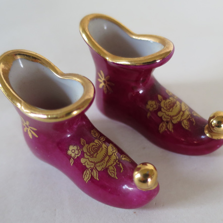 A pair of curly toe boots