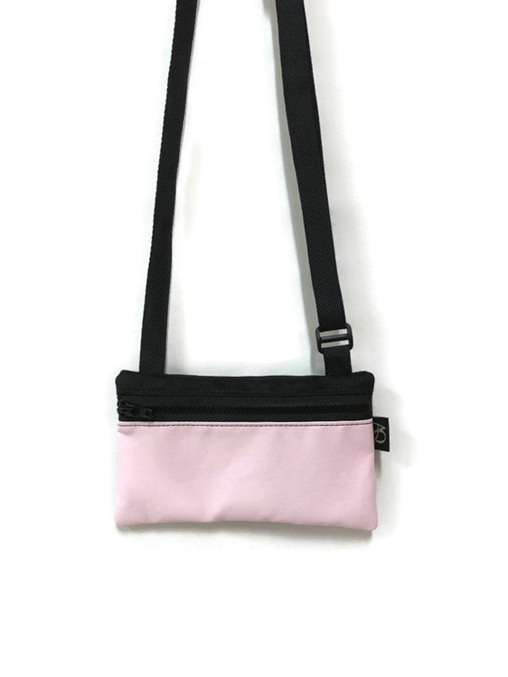 A pink bag to wear across your body, great for out dancing.