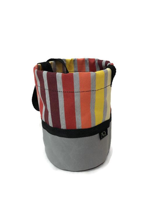 A rainbow peg bag made in NZ