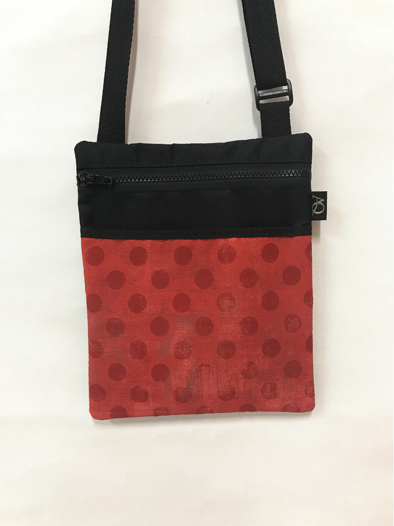A red Dory handbag great for across your body to keep hands free.