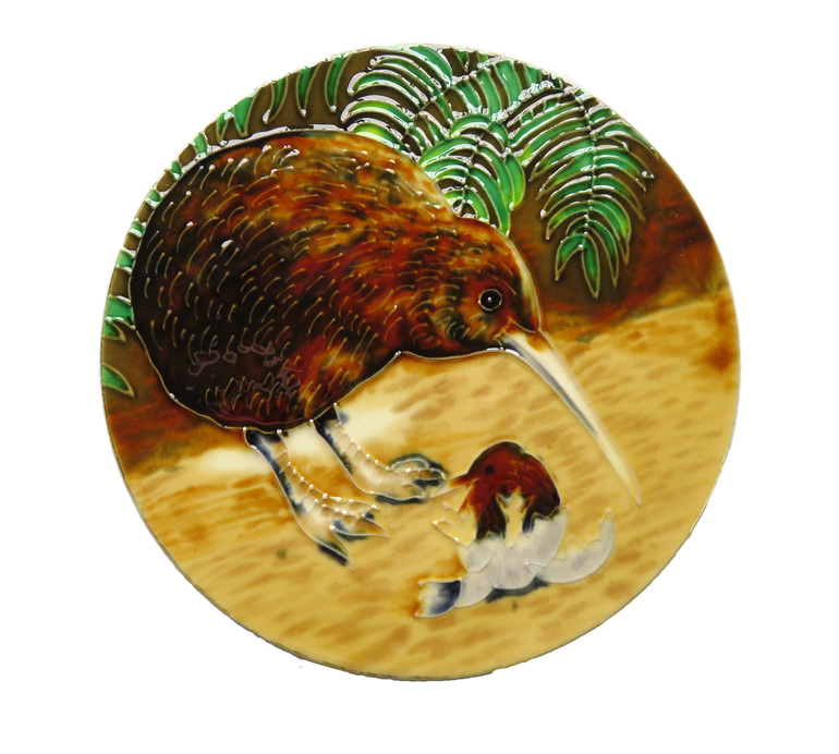 A small ceramic wall art tile depicting a Kiwi and chick.