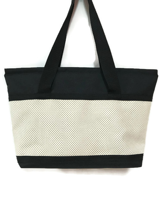 A Snapper bag in cream and teal.  great for women who love a big bag.