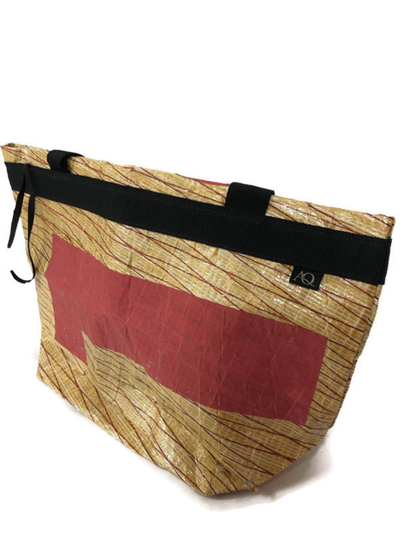 A supermarket shopping bag made from up cycled sails