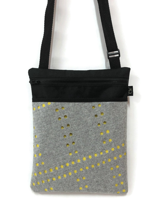 A winter handbag with grey and yellow made locally.