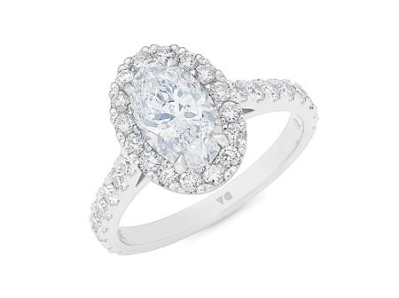 Adorn: Oval Diamond Halo Ring with Diamond Set Band