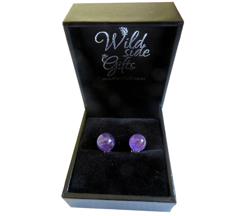 Amethyst stud earrings in jewellery box.