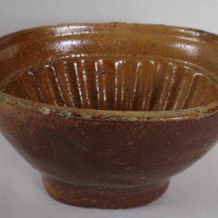 An old handmade pottery jelly mold