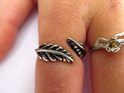 An oxidised sterling silver fern adjustable ring.