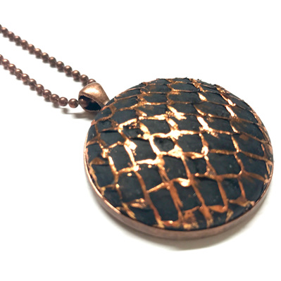 Antique copper pendant