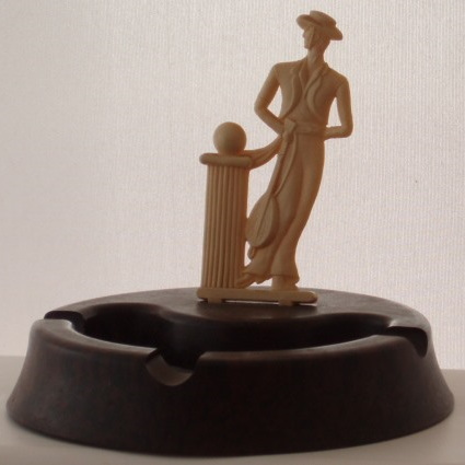 Art Deco gent decoration on bakelite ashtray