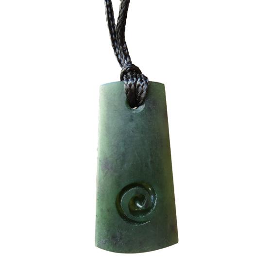 B121 Greenstone wedge-shaped toki or pendant with koru carving
