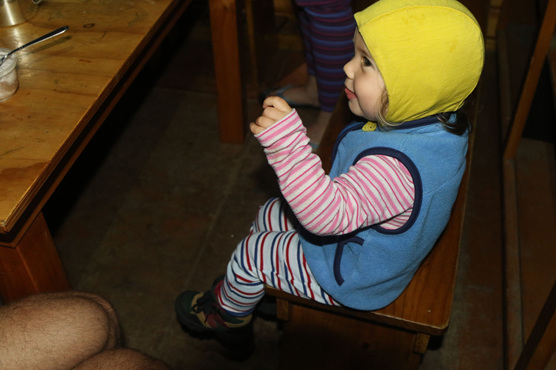 baby toddler in a doc hut in new zealand hike
