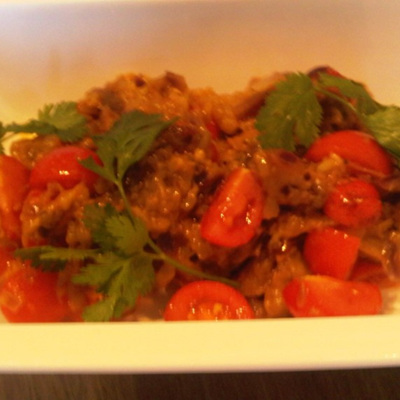 Baked aubergine and sweet cherry tomato indulgence in extra virgin olive oil