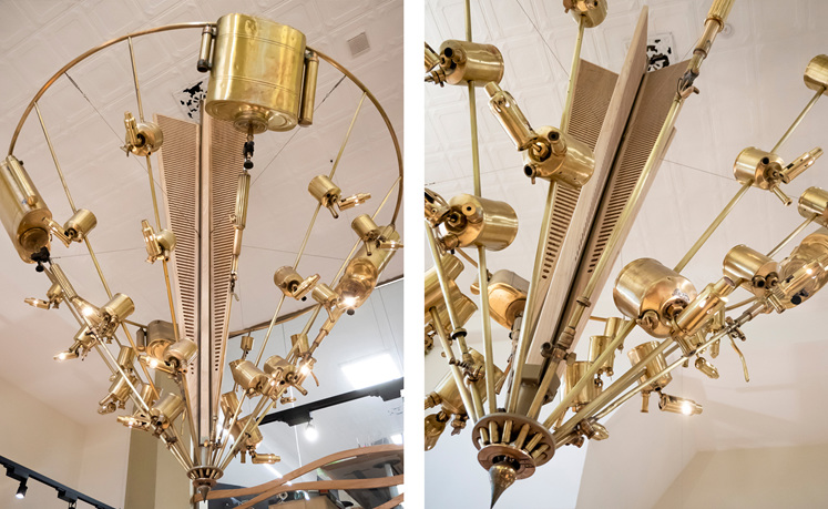 Beautiful gold chandelier built from antique tools and LED lights