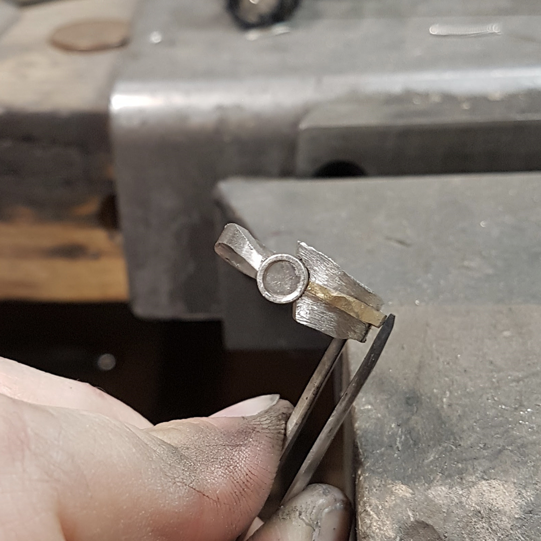 Yellow gold design feature laser welded to the ring's band