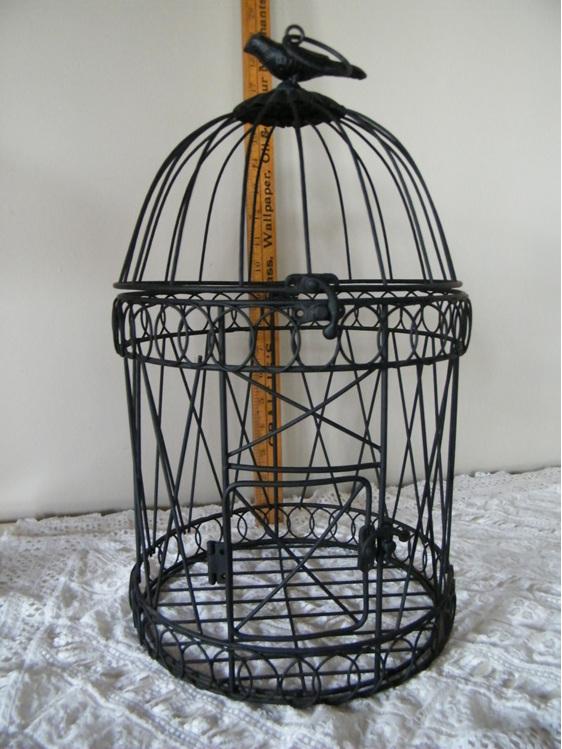 black decorative bird cage wedding and event hire