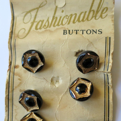 Black and gold glass buttons
