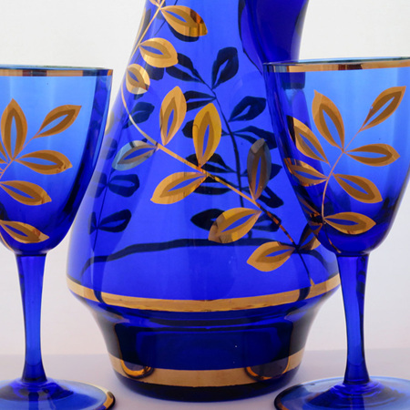 Blue and gold decanter and glasses