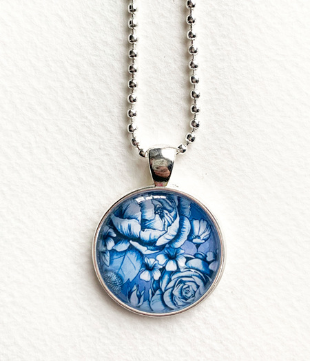Blue bloom pendant necklace - silver