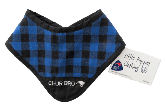 Blue bush dribble bib with Chur Bro embroidered onto it.
