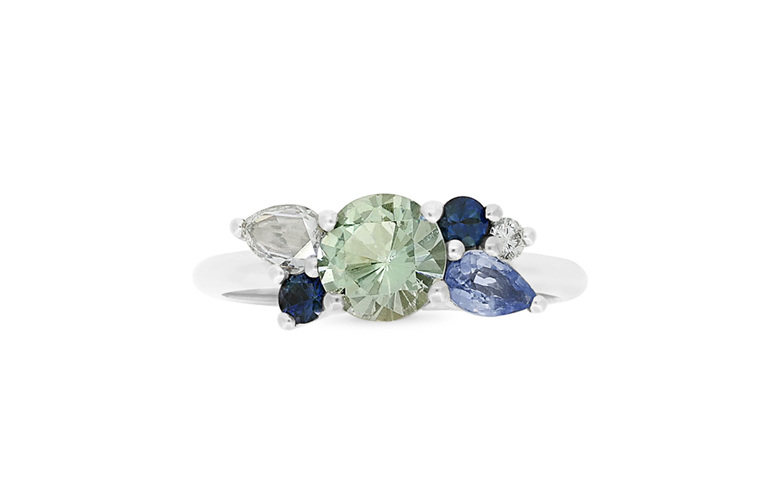 blue gemstone and diamond cluster ring