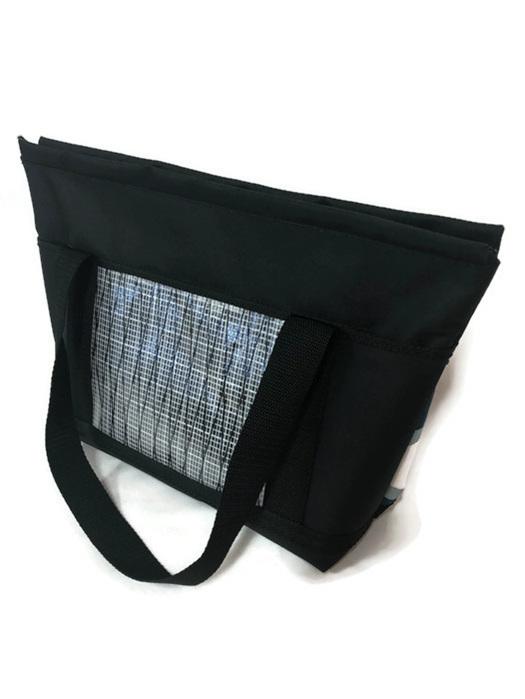 Blue leaf fabric on front of handbag, sailcloth on the bag.  NZ made