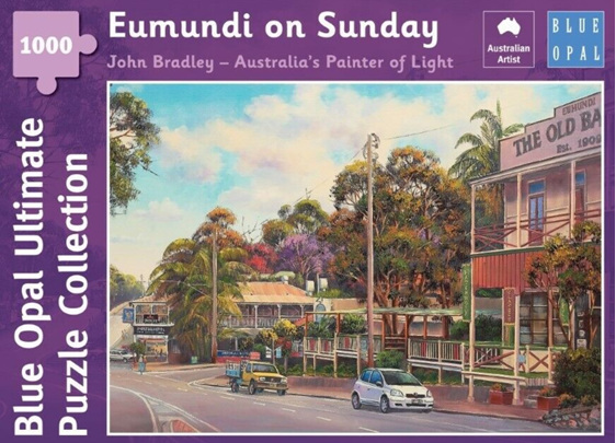 Blue Opal 1000 Piece  Puzzle  Eumundi On Sunday buy at www.puzzlesnz.co.nz