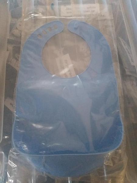 Blue plastic adjustable easy wipe bib