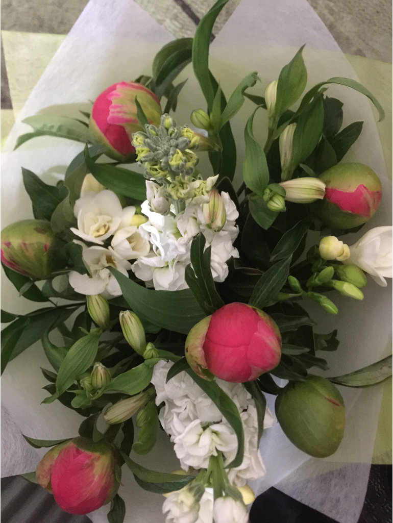 Bouquet with peonies in tight bud